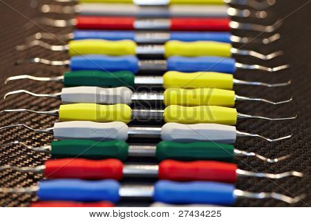 COLOGNE - MARCH 22: Different colorful dental scalers by Swiss manufacturer DEPPELER on display at the IDS Dental Industry trade show in Cologne, Germany on March 22, 2011.