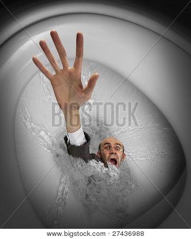 Businessman Sinking In Toilet Bowl