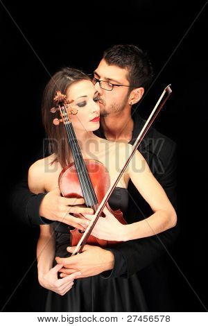 Violinist and his muse over black background