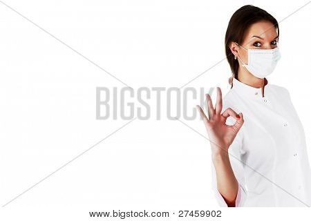 Portrait of successful young female doctor isolated on a white background