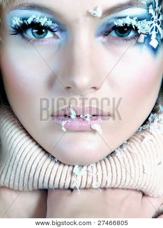 Frozen. Close-up portrait of chilled female face