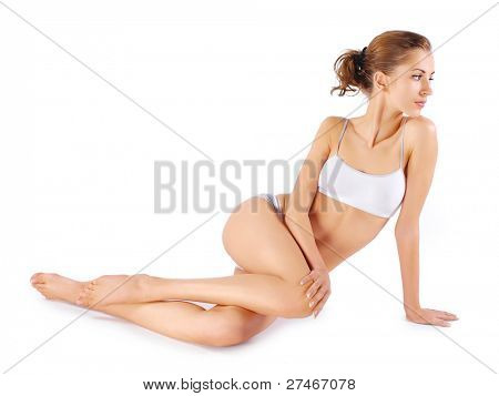 Young beautiful woman sitting on a floor