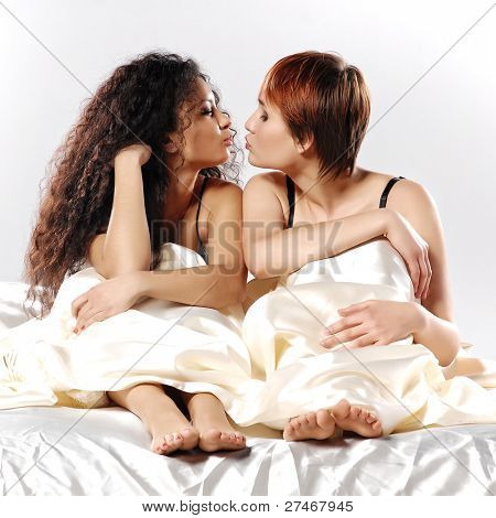Two girls in a bed