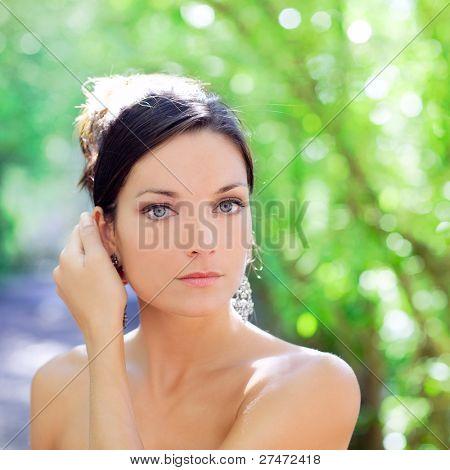 beautiful blue eyes woman outdoor green park portrait