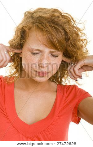 Young redheaded closing her ears with her fingers