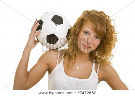 Young redheaded woman holding a soccer ball on her shoulders