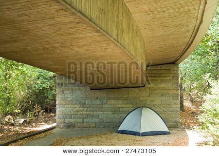 Tent under a bridge
