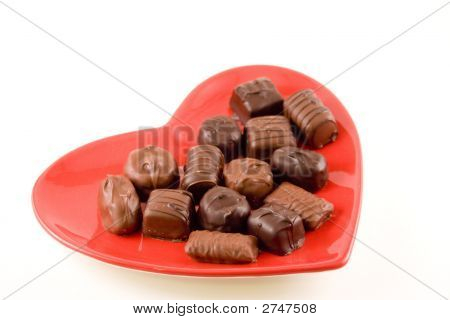 Chocolates On A Heart Shaped Plate.