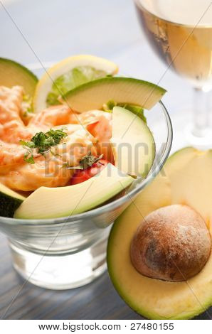 shrimp cocktail with avocado and wine