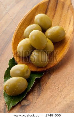 green olives over the spoon