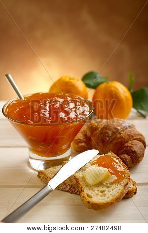 orange jam with toast and croissant