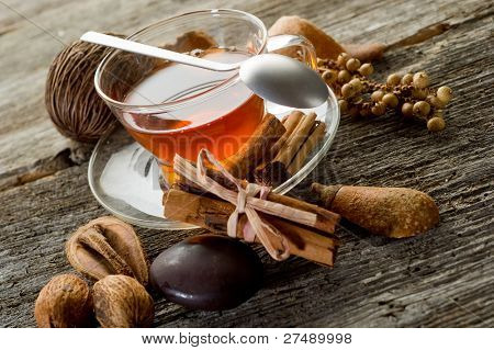 spiced tea over wood background