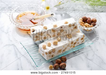 nougat with ingredients on marble table