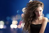 Brunette With Creative Hairstyle On Bokeh