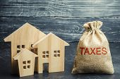 Bag With The Money And The Word Taxes And Wooden Houses. Taxes On Real Estate, Payment. Penalty, Arr poster
