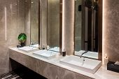 Row Of Modern Marble Ceramic Wash Basin In Public Toilet, Restroom In Restaurant Or Hotel Or Shoppin poster