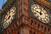 stock photo of big-ben  - looking up at big ben clock face during the evening - JPG