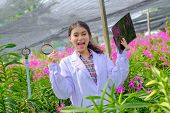 Researchers In Orchids In White Are Delighted With The Results Of Orchid Research. poster
