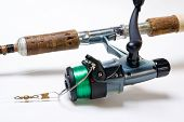 picture of fishing rod  - Detail of fishing rod and reel over white background - JPG