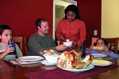 image of biscuits gravy  - Young Family having thanksgiving dinner in their home - JPG