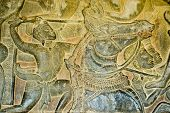 stock photo of mahabharata  - Detail of Angkor Wat bas relief sculpture showing Battle of Kurukshetra as described in the Mahabharata - JPG