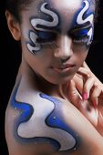 Portrait of mulatto girl with space face-art, body-art