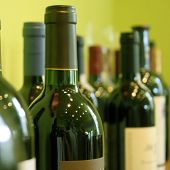 stock photo of wine bottle  - Some bottles of wine in a wine store - JPG