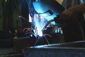 Steel Welding,welder,craftsman,worker Labourer At The Factory Welding Steel Structure, Erection Tech poster