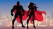 Illustration Of Silhouette Superhero Couple, Standing Tall On Rooftop Above City. poster
