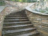stock photo of fieldstone-wall  - Maso photo of a masonry fieldstone staircase retaining wall - JPG
