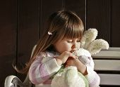 picture of easter bunnies  - Little girl hugging her stuffed white bunny