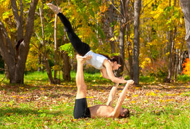 pic of tantra  - An attractive man and woman practice tantra yoga in forest - JPG