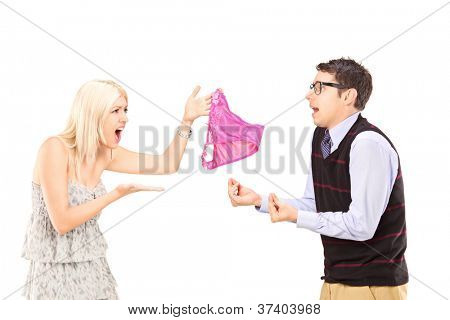 Young couple having a fight because of underwear isolated on white background