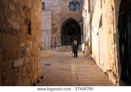 JERUSALEM - OCTOBER 02: The narrow street in the Old City of Jerusalem. October 02, 2006 in Jerusalem, Israel. Old Jerusalem is one of most sacred towns in the world.