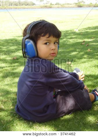 Young Boy With Headphones.