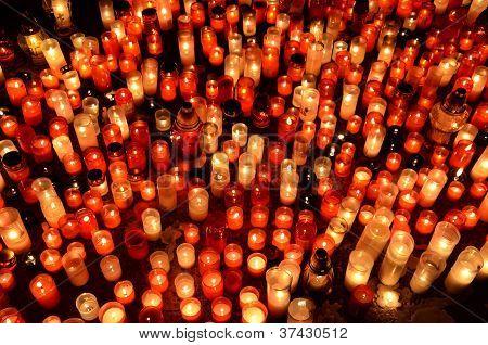 Many Burning Candles In Graveyard At Night