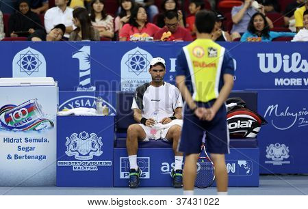 KUALA LUMPUR - SEP 28: Alejandro Falla (Col) takes a break at the ATP Tour Malaysian Open 2012 on September 28, 2012 at the Putra Stadium, Kuala Lumpur, Malaysia. He lost to Benneteau in the Q-final.
