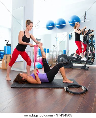 Aerobics pilates gym women personal trainer with ribber band