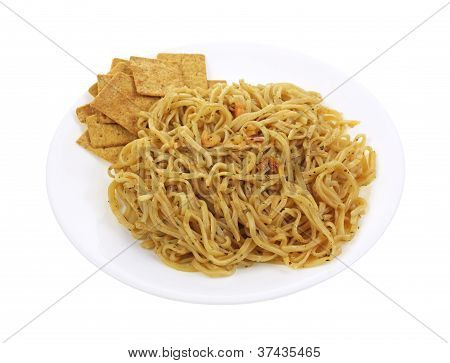 Noodles And Crackers On Plate