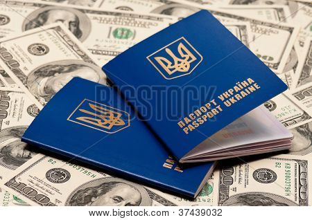 Two international Ukrainian passport on US dollars background