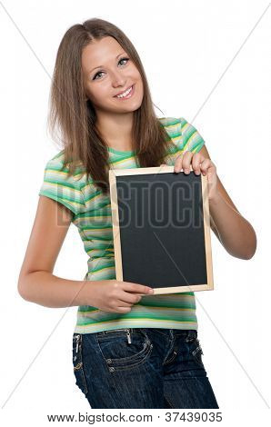 Beautiful teen girl with small blackboard posing on white background