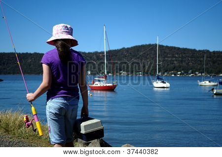 Young girl going fishing