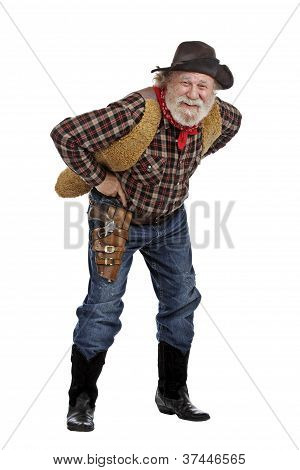 Smiling Old Cowboy Stands Leaning Forward