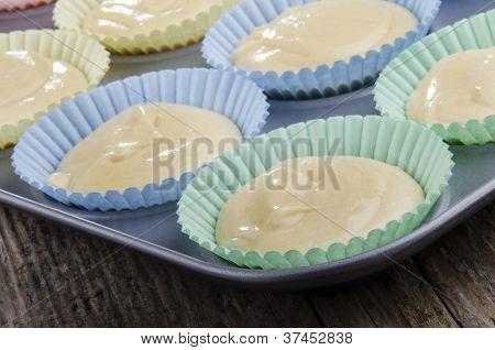 Vanilla Cake Batter In A Cupcake Baking Tin