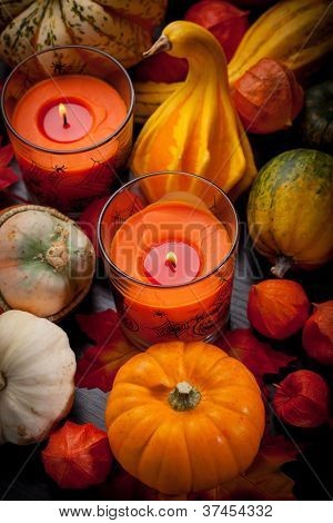 Happy Halloween - pumpkins and candles still life