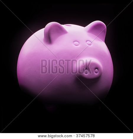Pink Ceramic Piggy Bank Isolated On Black Background