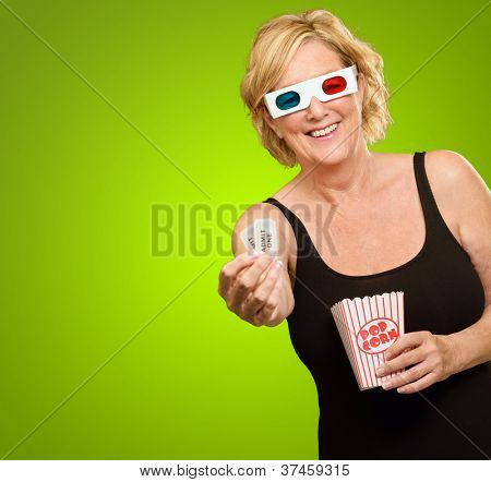 Happy Woman Wearing 3d Glasses Showing Ticket Isolated On Green Background