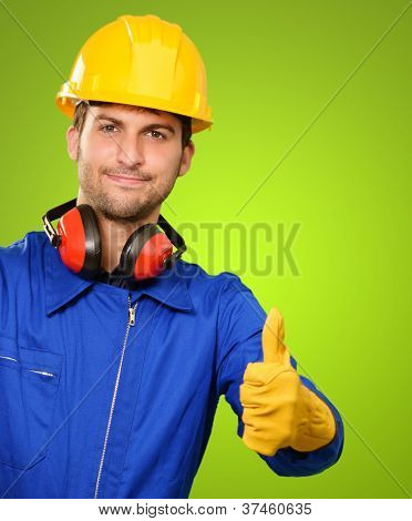 Engineer With Thumps Up Isolated On Green Background