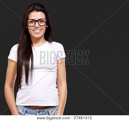 Portrait Of A Young Girl Wearing Specs Isolated On Black Background