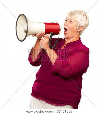 Portrait Of A Senior Woman mit Megaphon auf weißem Hintergrund